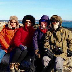 4 people bundled up for winter walk