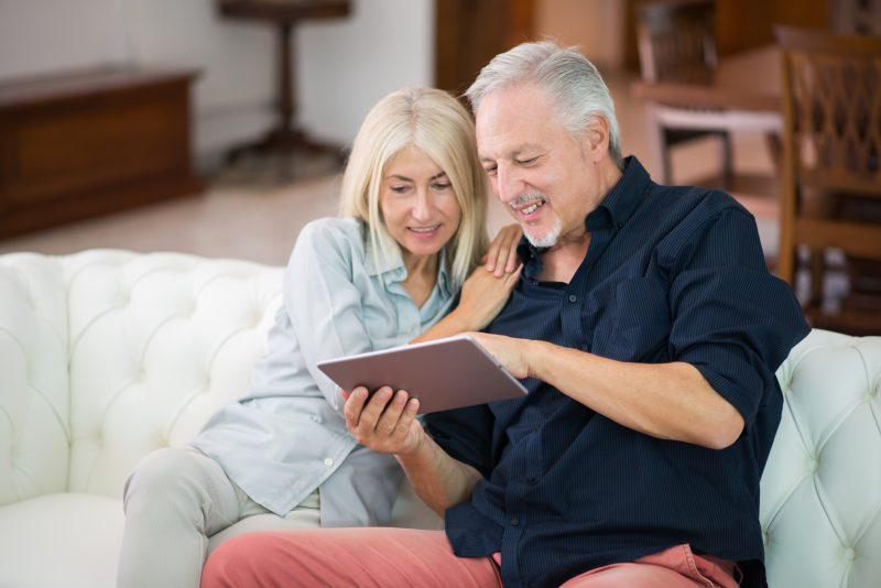 A couple looking at an iPad.